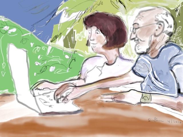 Woman and a man at a computer