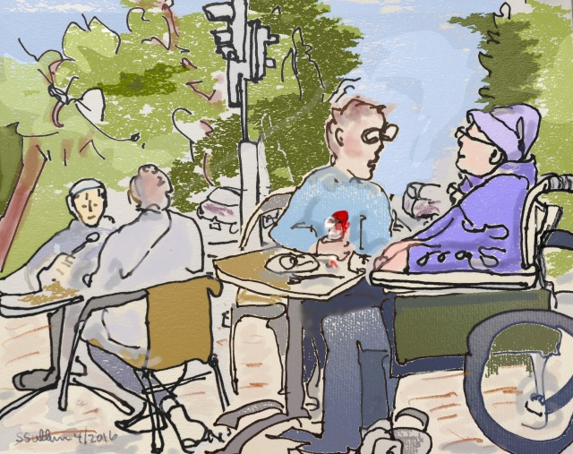 People eating at an outdoor ice cream shop